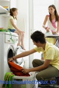 Siblings Doing Laundry Together